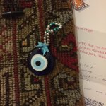The amulet, the bag (made from century old carpet) and Certificate of authenticity.