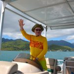 Bob takes the helm of a pontoon boat on nearby Kaneohe Bay