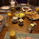 Scrumptious rosemary eggs, blueberry waffles, bacon, orange juice