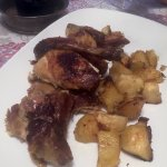 Guinea hen and potatoes at dinner