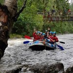 Happy paddlers rafting the Garry