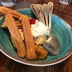 Churros with banana and ice cream. Delicious