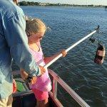Pulling up a crab pot.