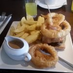 Steak sandwich, chips and onion rings