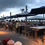 Picnic style dining outdoors with a storm rolling in at J.B.s Fish Camp