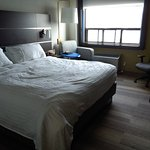 King bed looking toward window vier.