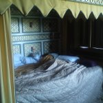 "My new 4' 11"" fiancee asleep in the 10' wide four poster bed in the Tower."