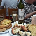 The edible crab, bread, and wine