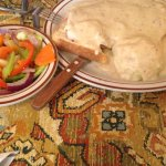 Open faced turkey plate with mashed potatoes and steamed vegetables.
