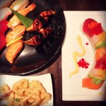 Sushi, dragon roll, and rice-battered fried calamari.