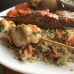 Lamb, chicken and seafood skewers with hummus and tzatki appetizers