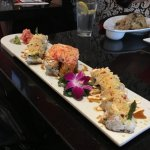 Lobster Roll on each end with a Volcano Roll in the center.