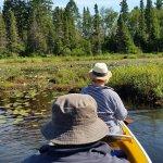 Paddling out on the lake. Beautiful Kevlar 3-man canoe.