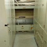 """Very """"cozy"""" sleeping quarters and lockers (about 30"""" hallway)."""