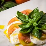 The Traditional Caprese Salad : Fresh Mozzarella, Tomatoes, Fresh Basil & Extra Virgin Olive Oil