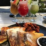 French toast with bacon, maple syrup, homemade grape jam and fresh made juices.