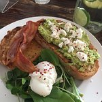 Smashed avocado on toast with a side of bacon - YUM!