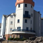 Keep walking along the marina and this building resembling a lighthouse is there.