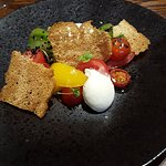 tomato salad with goats cheese curd and a lot of toast