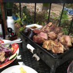 Argentinian BBQ with French fries and salad
