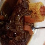 Braised lamb shank with Mexican rice