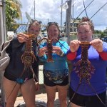 Ashley, Nancy and Casey showing off their lobsters!