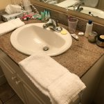 Housekeeping piles numerous towels on the edge of the vanity, leaving no place for your toiletri