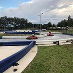 Racers tak a turn on the track based on the Sebring International Raceway