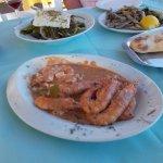 Delicious chicken souvlaki, lamb chops, garlic bread stuffed with feta cheese, fried anchovies,