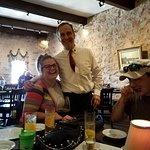 Our great waiter Jem with Rachel Bullard and Travis Bullard.