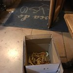 Waitress throws out our food in front of us into a cardboard box. Barbaric act. Please read revi
