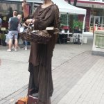 She poses as statue and will move for coins