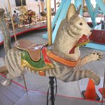 A cat holding a bird in its mouth on the Pullen Park carousel