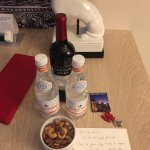 Complimentary wine, water, and nuts from the concierge.