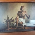 Portrait of Mahathma Gandhi  with spinning wheel