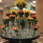 Stunning floral arrangements in reception area of Tower One