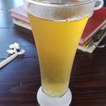 APPLE JUICE, not beer! Served in a cold glass with a ball of ice
