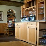 bogus wine-bottle cabinet/counter, mostly used by wait-staff. nice decor touch