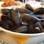Mussels and on the background Pasta with Bolognese Sauce
