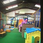 Indoor play area, green walls inside play area, overgrown go karting area, rubbish by disabled c