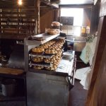 A view of the kitchen with the warm dinner rolls, hot from the oven.
