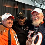 Brothers joking with Bronco Hall of Famer Floyd Little