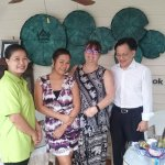 The owner and staff with Glenise