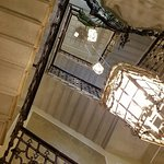 Stunning four stories tall light fixture in the stairwell