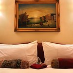 Zanzibar Suite, view of bed with daily chocolates