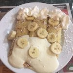 Delicious banana crepe with whipped cream