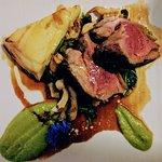 Lamb rump, wild mushrooms, potato lyonnaise, pea puree and spinach