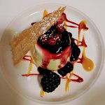 Panna cotta with summer berries and coconut tuile