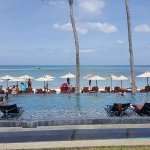 Beachfront infinity pool with in pool loungers