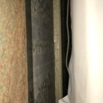 Dust on skirting board at top of headboard - double bed